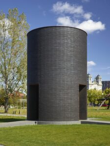 Theaster Gates, Black Vessel for a Saint, 2017, brick, granite, Cor-Ten steel, concrete, and statue of St. Laurence covered with roofing membrane, 280 x 192 inches (711.2 x 487.7 cm). Photo by Gene Pittman. Courtesy Walker Art Center, Minneapolis.